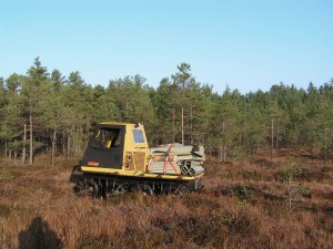 Low ground pressure wehicle is used for transportation of material to remote bog sites of difficult accessibility